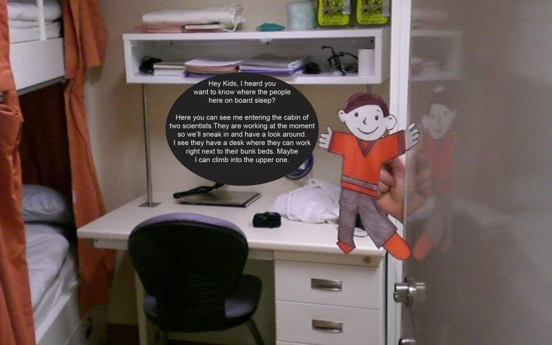 Flat Stanley looks into a cabin