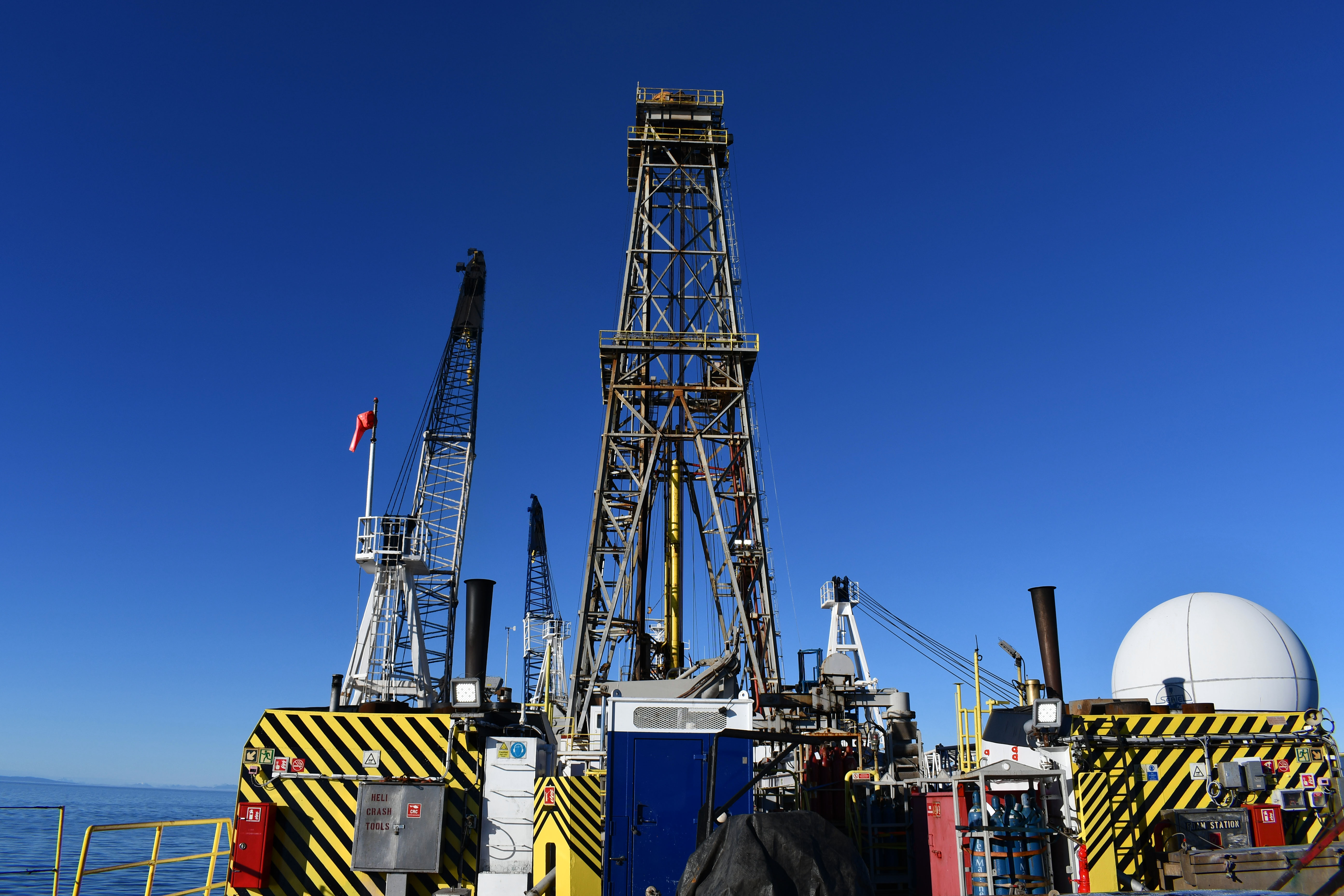 View from the ship's aft showing the towering derrick and cranes