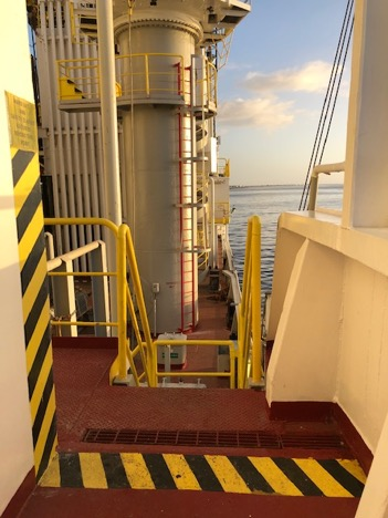 Walkway on deck showing the yellow and black hazard line