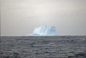 A large blocky iceberg on the horizon