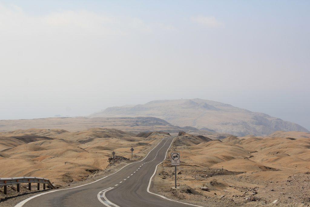 Chilean desert with road running through it.